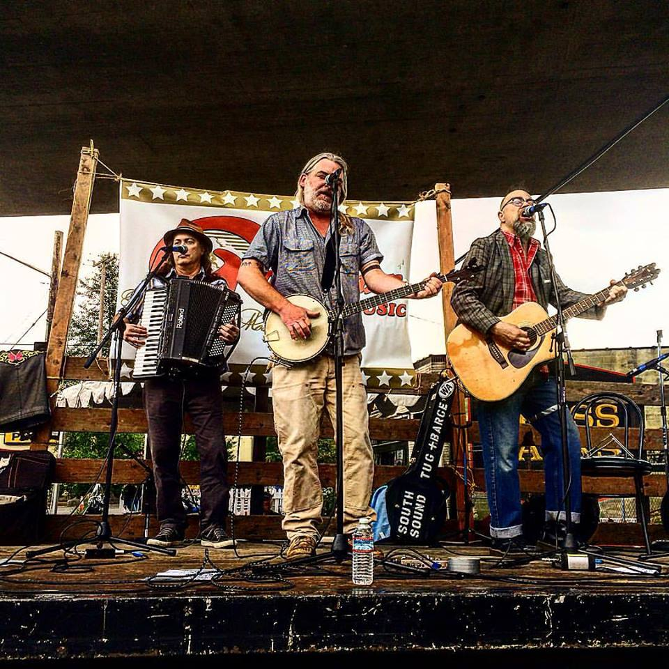 South Sound Tug & Barge live at the Georgetown Carnival Festival, summer 2016.  (l. to r. Charley Rowan, Steve Duda, Scott M.X. Turner)