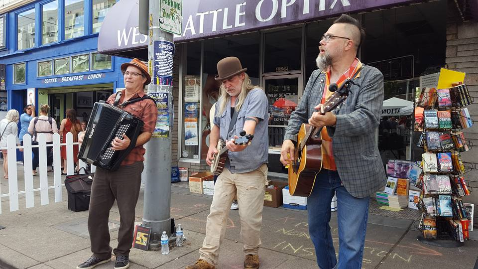 South Sound Tug & Barge live at the West Seattle Street Fest, July 2016 (i. to r. Charley Rowan, Steve Duda, Scott M.X. Turner)